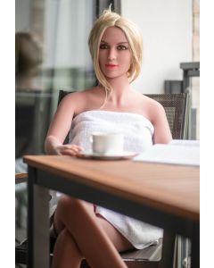 Levensechte Sekspop Jessy Summer aan tafel